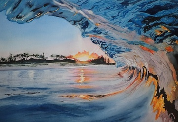 View inside a breaking wave at sunrise